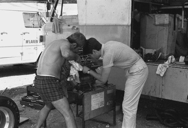 1970 Austrian Grand Prix Osterreichring, Speilberg, Austria. 16th August 1970. McLaren mechanics work on one of their engines in the paddock, portrait. World Copyright: LAT Photographic. Ref: 3251 - 5A.