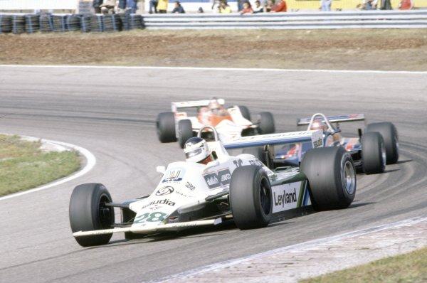 1980 Dutch Grand Prix.Zandvoort, Holland. 29-31 August 1980.Carlos Reutemann (Williams FW07B-Ford Cosworth) leads Mario Andretti (Lotus 81-Ford Cosworth) and John Watson (McLaren M29C-Ford Cosworth).World Copyright: LAT PhotographicRef: 35mm transparency 80HOL20