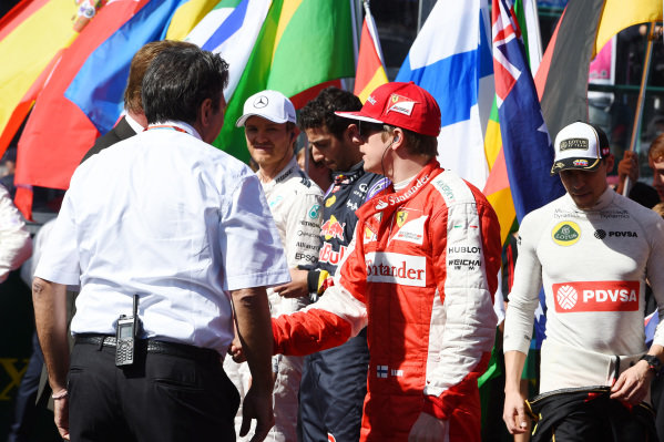 Arnold Schwarzenegger (AUT) Hollywood legend shakes hands with Kimi Raikkonen (FIN) Ferrari on the grid at Formula One World Championship, Rd1, Australian Grand Prix, Race, Albert Park, Melbourne, Australia, Sunday 15 March 2015.