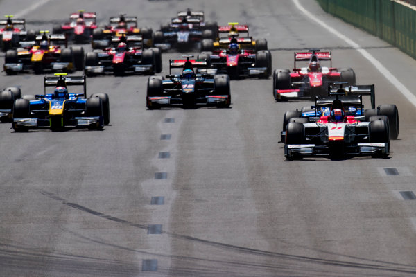 2017 FIA Formula 2 Round 4. Baku City Circuit, Baku, Azerbaijan. Sunday 25 June 2017. Ralph Boschung (SUI, Campos Racing) leads Oliver Rowland (GBR, DAMS) and the rest of the field at the start of the race. Photo: Zak Mauger/FIA Formula 2. ref: Digital Image _54I3170