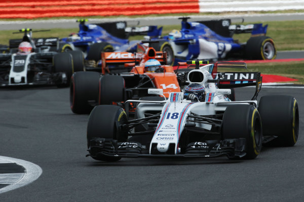 Silverstone, Northamptonshire, UK.  Sunday 16 July 2017. Lance Stroll, Williams FW40 Mercedes, leads Fernando Alonso, McLaren MCL32 Honda, and Kevin Magnussen, Haas VF-17 Ferrari. World Copyright: Charles Coates/LAT Images  ref: Digital Image AN7T1471