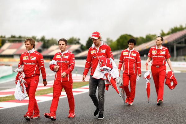 Circuit de Catalunya, Barcelona, Spain. Thursday 11 May 2017. Sebastian Vettel, Ferrari, is accompanied on a track walk by colleagues. World Copyright: Andy Hone/LAT Images ref: Digital Image _ONY2997