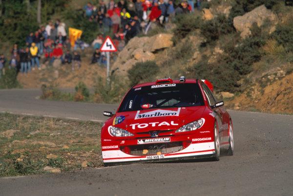2003 World Rally Championship, Catalunya, Spain, Rd13. 23 - 26 October 2003.Richard Burns, Peugoet 206 WRC ActionWorld Copyright: McKlein/LAT PhotographicRef: Transparency 03_WRC_Rd13_20