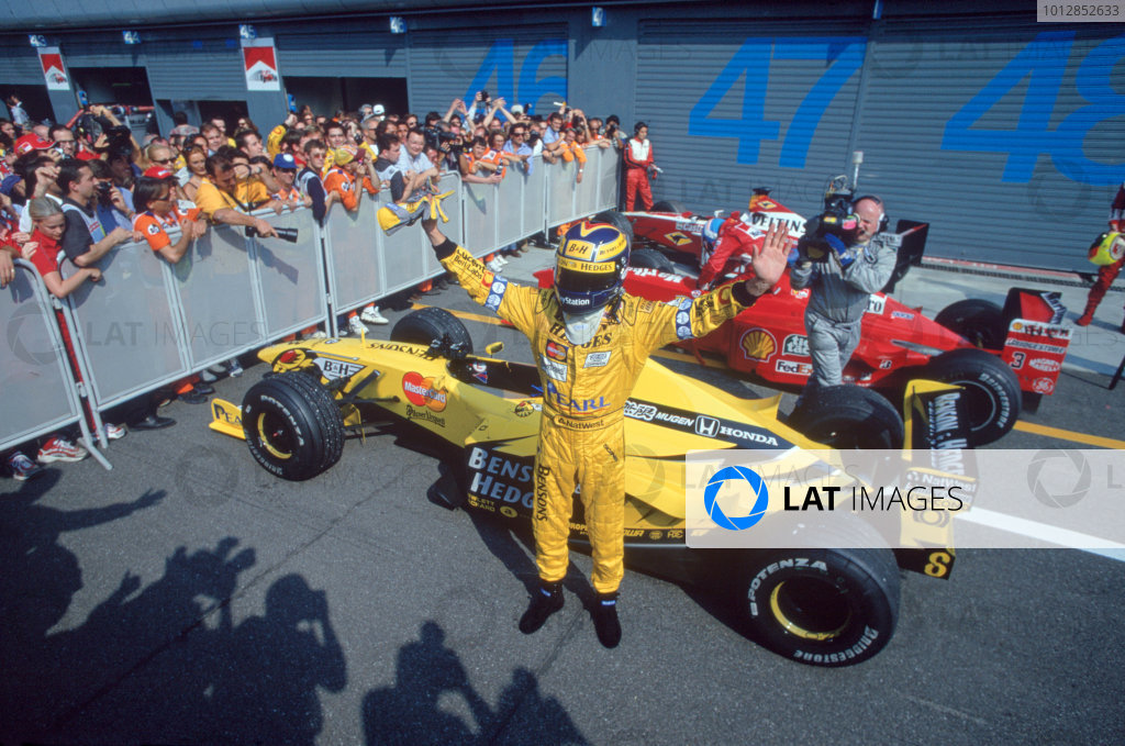 1999 Italian Grand Prix. Monza, Italy. 10-12 September 1999. Heinz-Harald Frentzen (Jordan Mugen Honda) celebrates his 1st position in parc ferme. Ref-99 ITA 02. World Copyright: Steven Tee/LAT Photographic Ref: 35mm Image 99 ITA 02