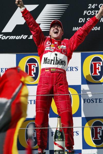 2004 San Marino Grand Prix - Sunday Race,2004 San Marino Grand Prix Imola, Italy. 25th April 2004.Michael Schumacher celebrates a dominant win in front of the Tifosi crowd. World Copyright: Steve Etherington/LAT Photographic ref: Digital Image Only