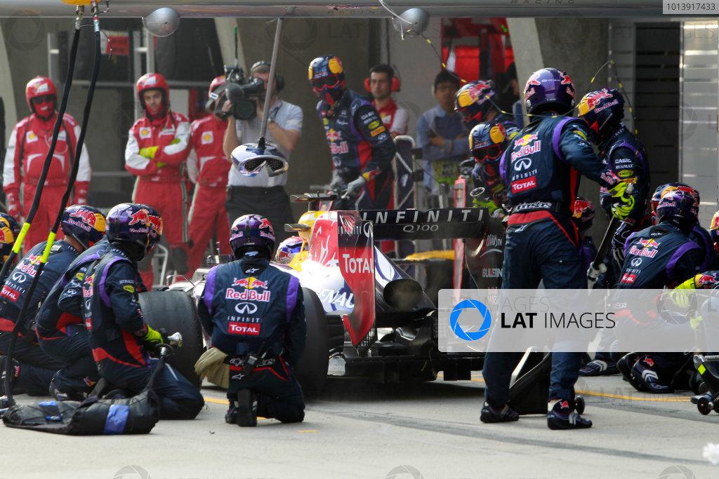 Shanghai International Circuit, Shanghai, China Sunday 14th April 2013 Sebastian Vettel, Red Bull RB9 Renault, makes a stop. World Copyright: Glenn Dunbar/LAT Photographic ref: Digital Image _G7C8375