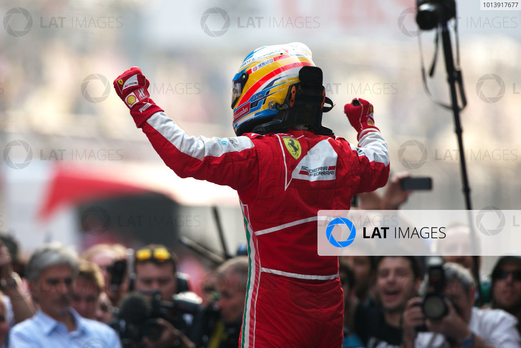 Shanghai International Circuit, Shanghai, China Sunday 14th April 2013 Fernando Alonso, Ferrari, 1st position, celebrates upon arrival in Parc Ferme. World Copyright: Andy Hone/LAT Photographic ref: Digital Image HONZ7713