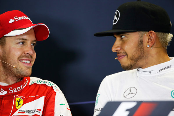 Sochi Autodrom, Sochi, Russia. Sunday 11 October 2015. Sebastian Vettel, Ferrari, 2nd Position, and Lewis Hamilton, Mercedes AMG, 1st Position, in the Press Conference. World Copyright: Alastair Staley/LAT Photographic. ref: Digital Image _R6T2638