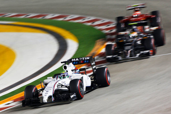 Marina Bay Circuit, Singapore. Sunday 21 September 2014. Felipe Massa, Williams FW36 Mercedes, leads Esteban Gutierrez, Sauber C33 Ferrari. World Copyright: Andrew Hone/LAT Photographic. ref: Digital Image _ONZ7934