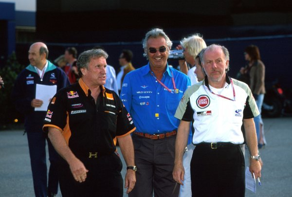L-R: Team Principal's Tom Walkinshaw (GBR) Arrows, Flavio Briatore (ITA) Renault and David Richards (GBR) British American Racing. In the background on the left is Peter Sauber (SUI).Austrian Grand Prix, Rd6, A1-Ring, Austria. 13 May 2002.BEST IMAGE