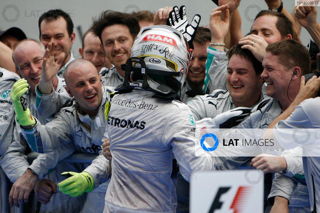 Sepang International Circuit, Sepang, Kuala Lumpur, Malaysia. Sunday 30 March 2014. Lewis Hamilton, Mercedes AMG, 1st Position, celebrates with his team in Parc Ferme. World Copyright: Steve Etherington/LAT Photographic. ref: Digital Image MAL-RACE-R-5111 copy