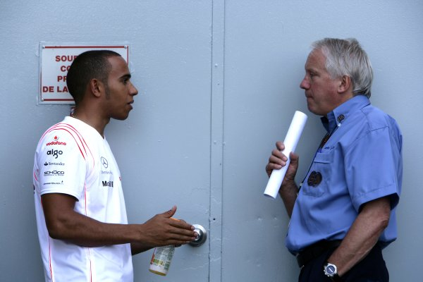 2007 Canadian Grand Prix - Friday PracticeMontreal, Canada.8th June 2007.Lewis Hamilton, McLaren MP4-22 Mercedes, with Charlie Whiting, FIA Technical Delegate. Portrait. World Copyright: Charles Coates/LAT Photographicref: Digital Image ZK5Y4156