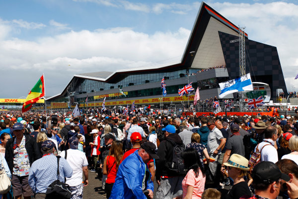 Silverstone, Northamptonshire, England. Sunday 5 July 2015. Fans invade the circuit after the race to see the podium celebrations. World Copyright: Zak Mauger/LAT Photographic. ref: Digital Image _MG_1123