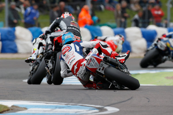 2015 World Superbike Championship.  Donington Park, UK.  23rd - 24th May 2015.  Michael van der Mark, Pata Honda, crashes at the Esses.  Ref: KW7_5900a. World copyright: Kevin Wood/LAT Photographic