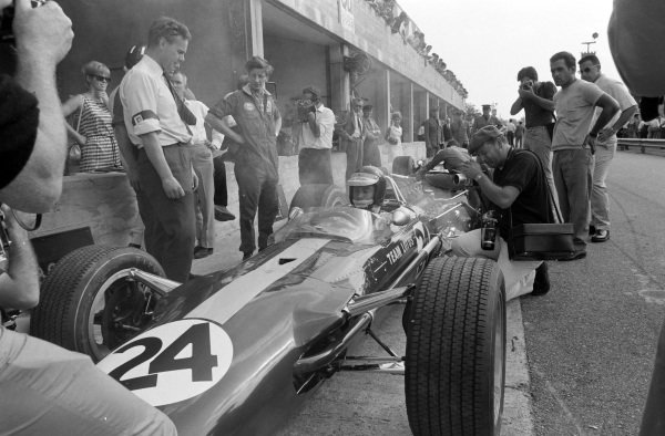 Jim Clark in Giancarlo Baghetti's Lotus 49 Ford with Keith Duckworth standing alongside.