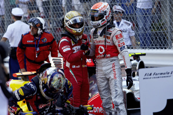 Fernando Alonso shakes hands with Jenson Button after the race.