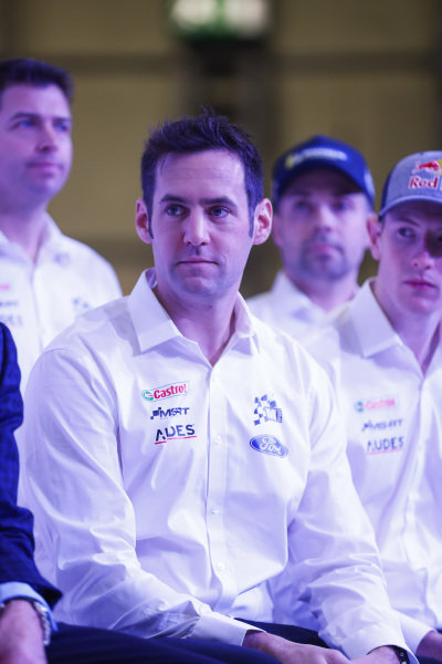 Colin Clark talks to the Ford WRC team on the Autosport Stage.
