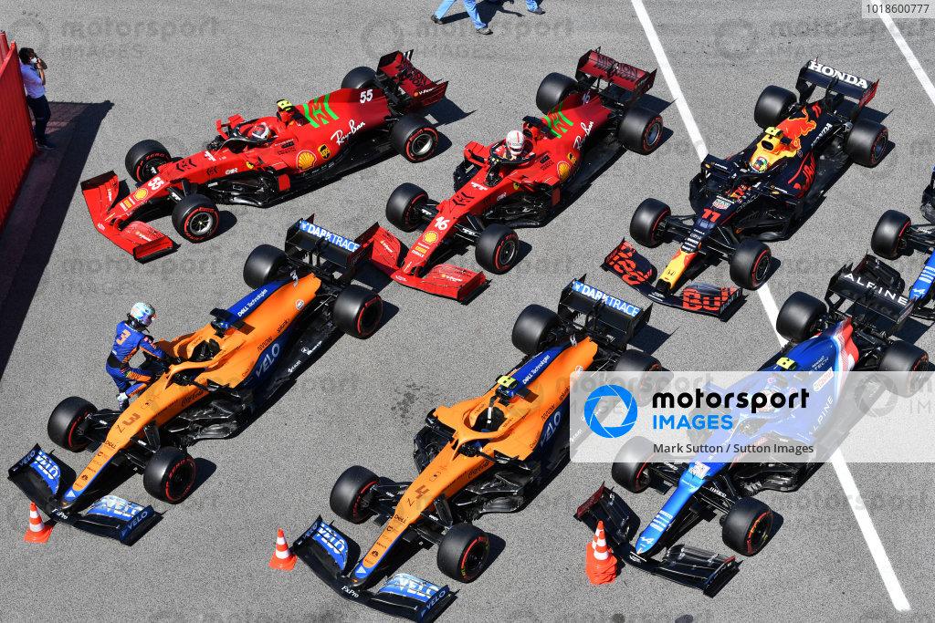 The cars of Daniel Ricciardo, McLaren MCL35M, Lando Norris, McLaren MCL35M, Esteban Ocon, Alpine A521, Carlos Sainz, Ferrari SF21, Charles Leclerc, Ferrari SF21, Sergio Perez, Red Bull Racing RB16B, and Fernando Alonso, Alpine A521, in Parc Ferme after Qualifying