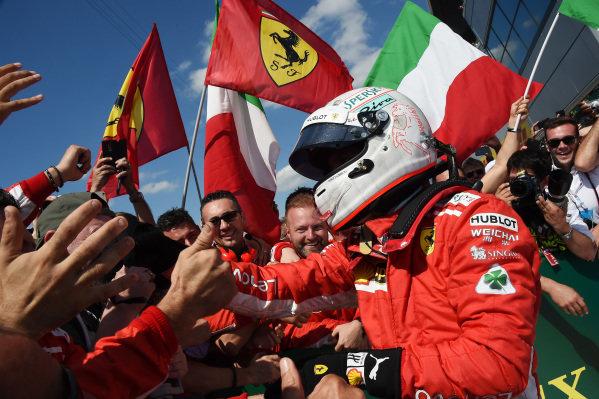 Race winner Sebastian Vettel (GER) Ferrari celebrates in parc ferme