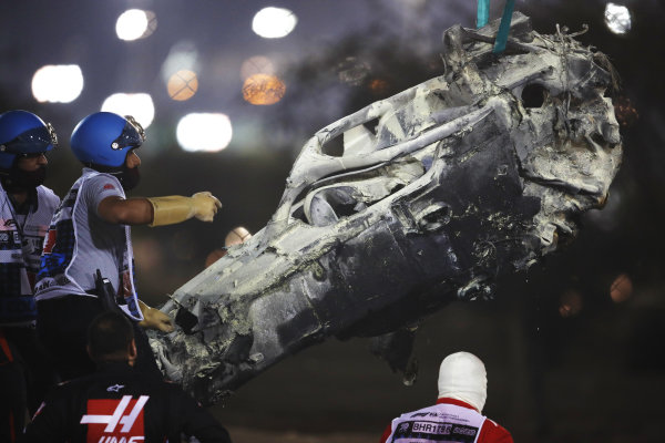 Marshals remove the wreckage after a huge crash for Romain Grosjean, Haas VF-20, on the opening lap