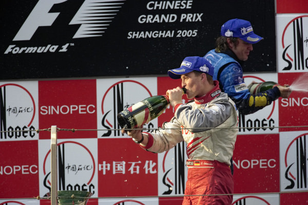 Ralf Schumacher, 3rd position, celebrates on the podium.
