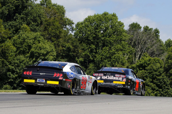 #98: Chase Briscoe, Stewart-Haas Racing, Ford Mustang Ford Performance and #74: Aaron Quine, Mike Harmon Racing, Chevrolet Camaro