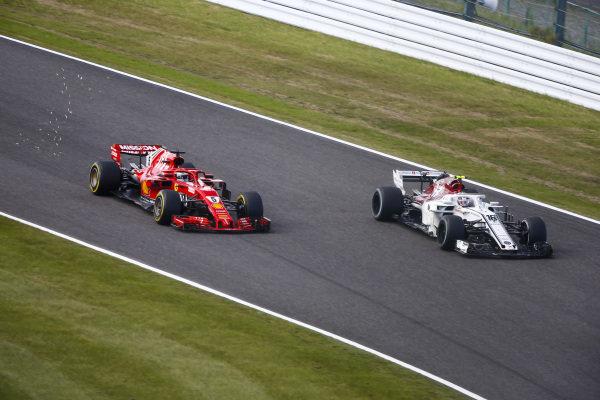 Sebastian Vettel, Ferrari SF71H, passes Charles Leclerc, Sauber C37 Ferrari
