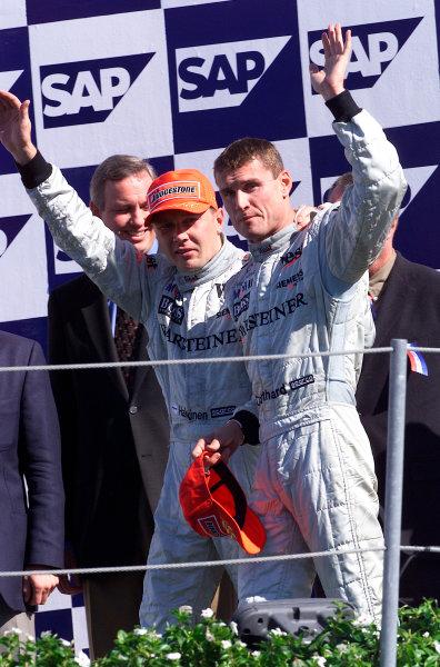 2001 American Grand Prix - RaceIndianapolis, United States. 30th September 2001.Race winner Mika Hakkinen, West McLaren Mercedes MP4/16, celebrates his victory. Podium.World Copyright: Steve Etherington/LAT Photographicref: 18mb Digital Image