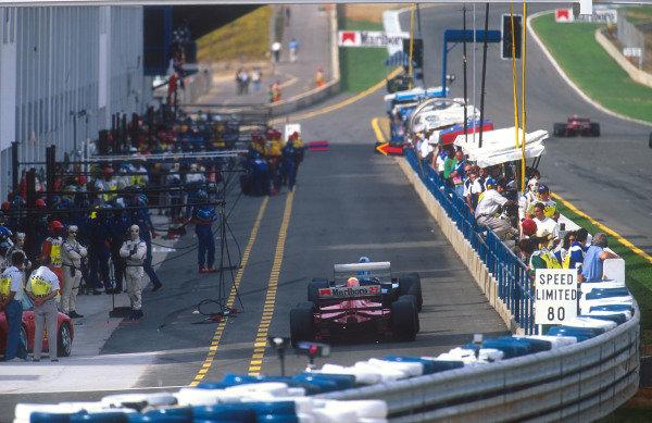 1994 European Grand Prix.Jerez, Spain.14-16 October 1994.Jean Alesi (Ferrari 412T1B) follows a Ligier down the pit lane prior to his pitstop.Ref-94 EUR 14.World Copyright - LAT Photographic