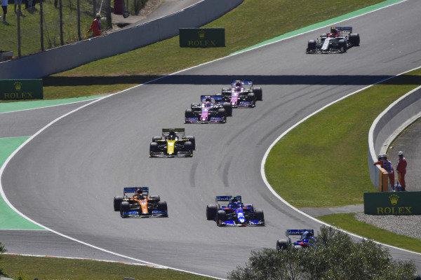Alexander Albon, Toro Rosso STR14, leads Carlos Sainz Jr., McLaren MCL34, and Daniel Ricciardo, Renault R.S.19