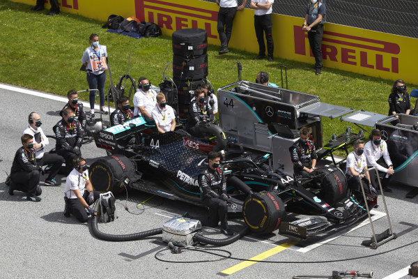Mercedes team members kneel on the grid next to the Lewis Hamilton Mercedes F1 W11 EQ Performance