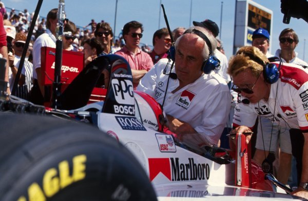 Al Unser Jr (USA) Penske PC23 Mercedes, in-car, talks with team boss Roger Penske (USA) and his engineers.