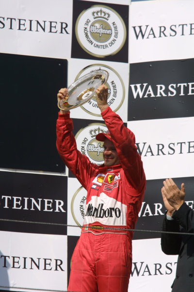 2001 San Marino Grand Prix.Imola, Italy. 13-15 April 2001.Rubens Barrichello (Ferrari) celebrates his 3rd position on the podium.World Copyright - LAT Photographicref: 8 9 MB Digital
