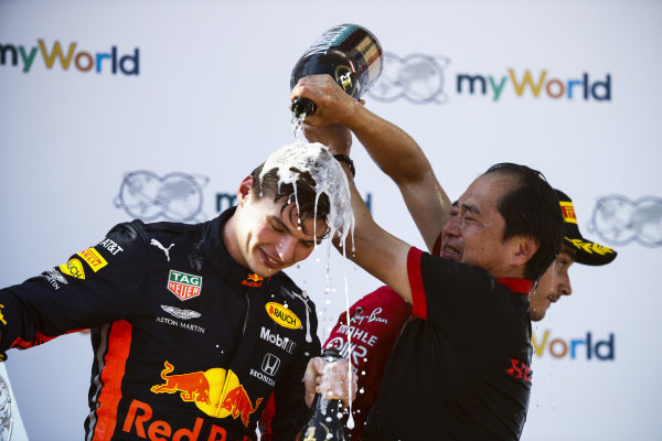 Toyoharu Tanabe, F1 Technical Director, Honda, pours Champagne over Max Verstappen, Red Bull Racing, 1st position
