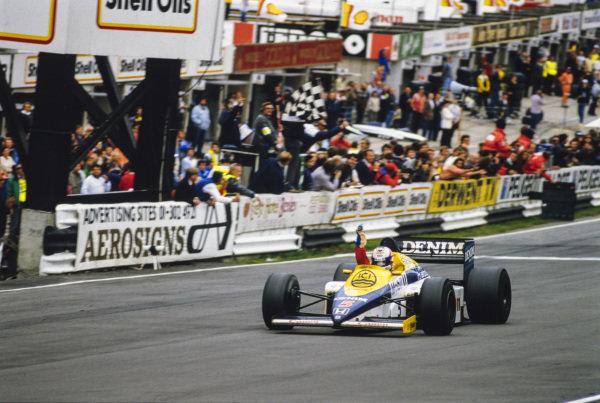 Nigel Mansell, Williams FW10 Honda, celebrates his first grand prix win.