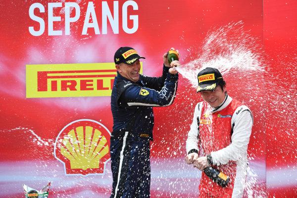 Philippe Prette, Blackbird Concessionaires HK, celebrates victory with champagne alongside Nobuhiro Imada, Rosso Scuderia on the podium
