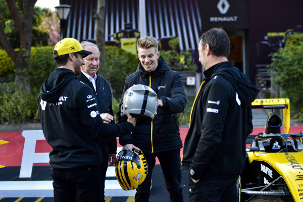 Daniel Ricciardo, Renault F1 Team, and Nico Hulkenberg, Renault F1 Team, examine each other's helmets.