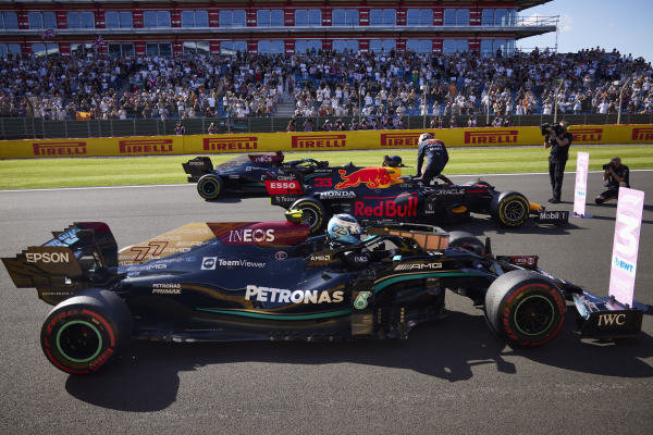 Valtteri Bottas, Mercedes W12, 3rd position, Max Verstappen, Red Bull Racing RB16B, 1st position, and Sir Lewis Hamilton, Mercedes W12, 2nd position, at the end of the Sprint Qualifying race