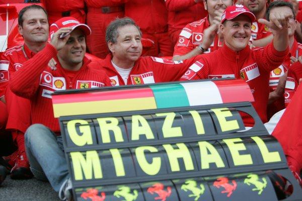 2006 Brazilian Grand Prix - Sunday Race Interlagos, Sao Paulo, Brazil. 19th - 22nd October 2006. The Ferrari team say goodbye to Michael Schumacher after the 7 times World Champion retires, portrait. World Copyright: Lorenzo Bellanca/LAT Photographic ref: Digital Image MU4Z4381