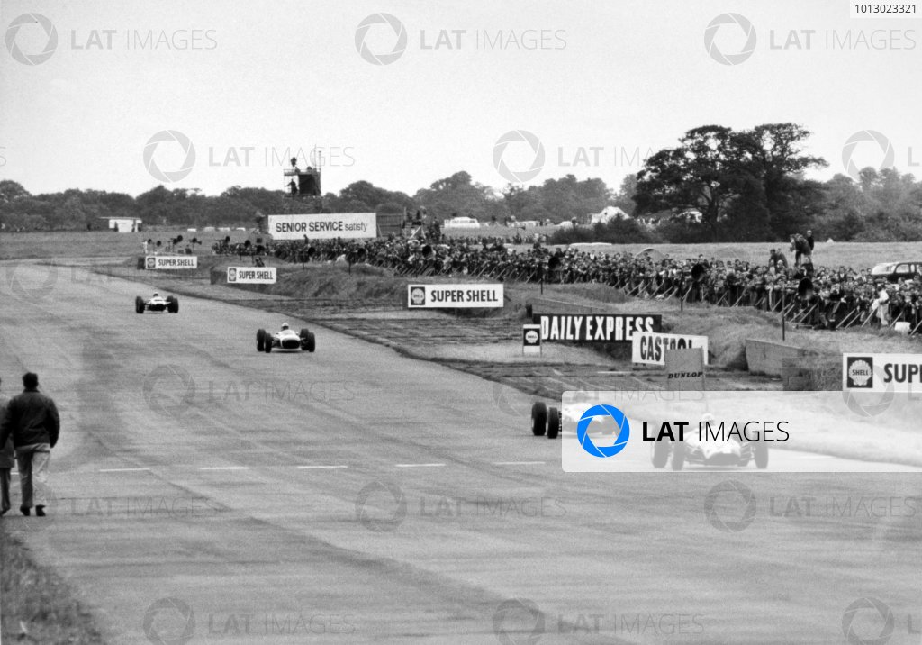 1965 British Grand Prix.Silverstone, Great Britain. 10 July 1965.Ian Raby, Brabham BT3-BRM, 11th position, leads a group of cars, action.World Copyright: LAT Photographic