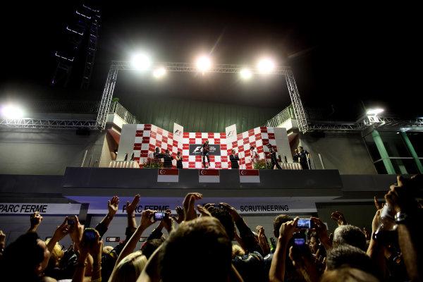 Marina Bay Circuit, Singapore.25th September 2011.Sebastian Vettel, Red Bull Racing RB7 Renault, 1st position, leaps up in celebration. Portrait. Podium. World Copyright:Glenn Dunbar/LAT Photographicref: Digital Image IMG_1734