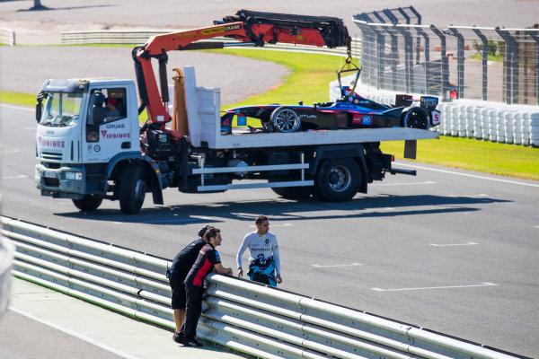 2017/2018 FIA Formula E Championship. Official Test - Valencia, Spain Tuesday 3 October 2017. Sebastien Buemi (SUI), Renault e.Dams, Renault Z.E 17 inspects the damage to the 1st chicane after James Rossiter (GBR), Venturi Formula E Team, Venturi VM200-FE-03 crashes at the chicane Photo: Sam Bloxham/LAT/Formula E ref: Digital Image _J6I9612