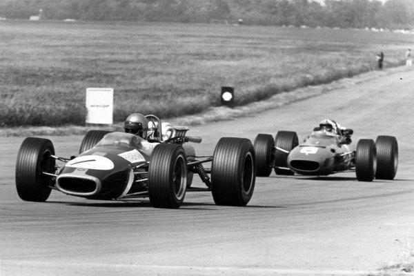 1967 British Grand Prix.Silverstone, Great Britain. 15 July 1967.Jack Brabham, Brabham BT24-Repco, 4th position, leads Chris Amon, Ferrari 312, 3rd position, action.World Copyright: LAT PhotographicRef: Motor b&w print