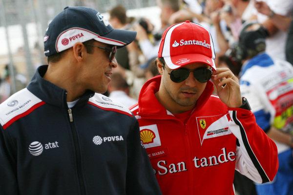 Pastor Maldonado (VEN) Williams and Felipe Massa (BRA) Ferrari.  Formula One World Championship, Rd 9, British Grand Prix, Race, Silverstone, England, Sunday 10 July 2011.