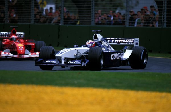 Juan Pablo Montoya (COL) Williams BMW FW24 leads Michael Schumacher (GER) Ferrari F2001 as they battle for the lead.