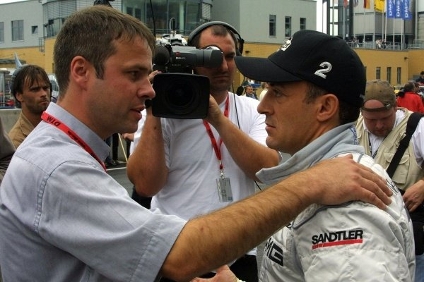 Jean Alesi (FRA) AMG Mercedes is interviewed for television.