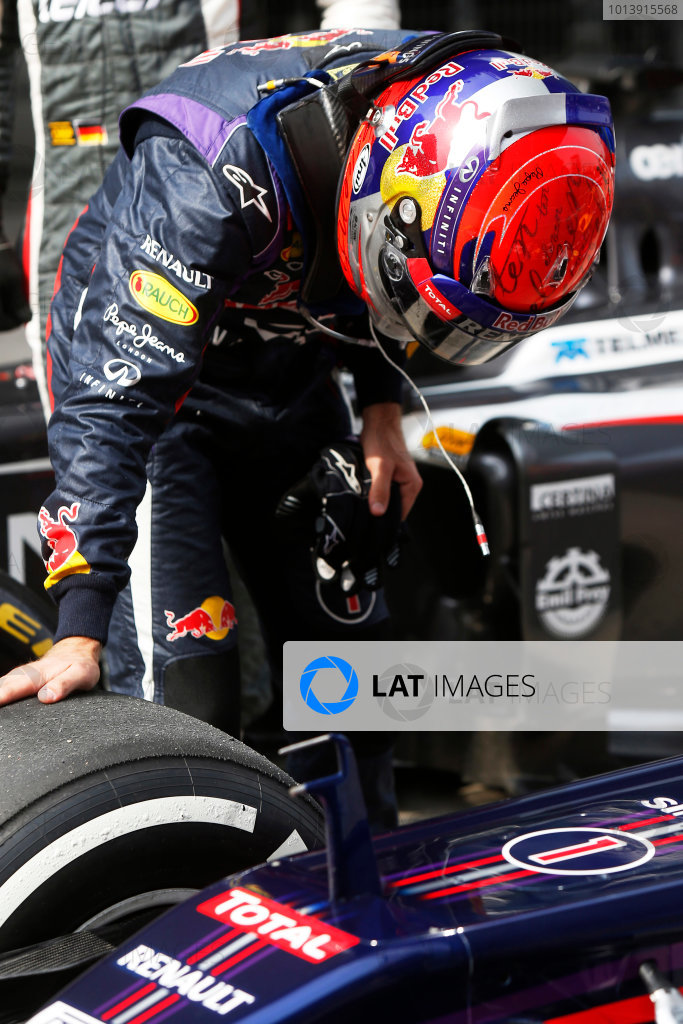 Shanghai International Circuit, Shanghai, China Saturday 13th April 2013 Sebastian Vettel, Red Bull Racing, checks his tyres in Parc Ferme. World Copyright: Charles Coates/LAT Photographic ref: Digital Image _N7T4345