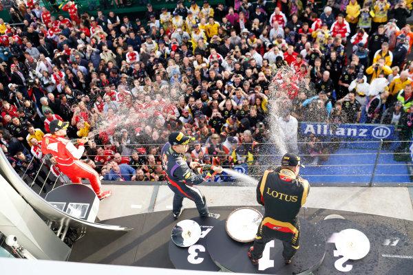 Albert Park, Melbourne, Australia Sunday 17th March 2013 Sebastian Vettel, Red Bull Racing, 3rd position, and Fernando Alonso, Ferrari, 2nd position, spray Kimi Raikkonen, Lotus F1, 1st position, with Champagne. World Copyright: Steven Tee/  ref: Digital Image _14P1053