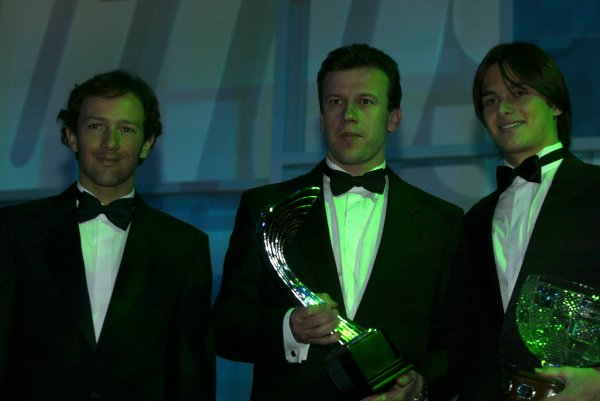 2003 AUTOSPORT AWARDS, The Grosvenor, London. 7th December 2003.Toyota F1 duo, Cristiano Da Matta and Olivier Panis hand Nelson Piquet Jnr the Paul Warwick trophy for National Driver.Photo: Peter Spinney/LAT PhotographicRef: Digital Image only