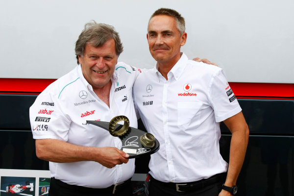 Valencia Street Circuit, Valencia, Spain22nd June 2012.Martin Whitmarsh, Team Principal, McLaren, receives a trophy from Norbert Haug, Vice President, Mercedes-Benz High Performance Engines, made using the wheel nut from the winning car of Lewis Hamilton last weekend and the wheel nut from the race winning MP4-12 of David Coulthard from the 1997 Australian Grand Prix.World Copyright:Charles Coates/LAT Photographicref: Digital Image _26Y9055